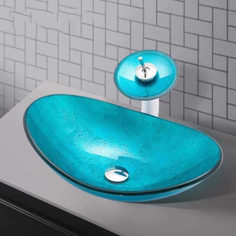 grifo y lavabo de cristal azul
